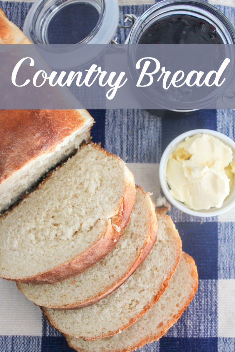country bread on table with butter. This easy recipe makes a great white country bread. #bread #breadrecipes #easyrecipe #countrybread #whitebread