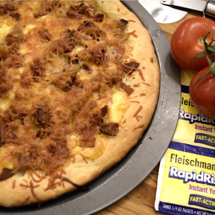 Pellet Grill Pizza with Gouda, Caramelized Onion, Tomato, and Bacon